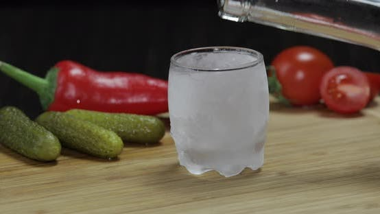 Man Puts Icy Glass Then Fills It with Vodka and Picks Up a Glass