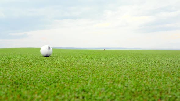 Thumbnail for White Recycled Golf Ball Against the Skyline in the Background