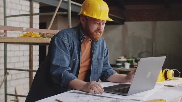 Architect Video Calling on Laptop at Construction Site