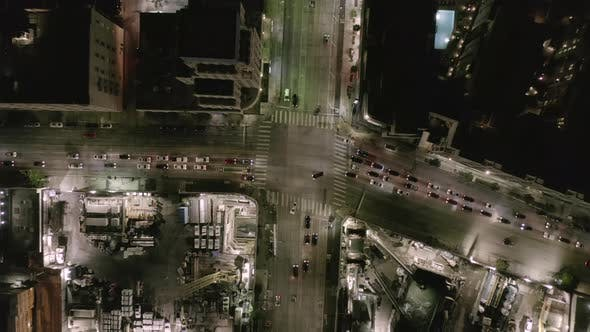Thumbnail for AERIAL: Overhead Rising on Intersection Street with Big Construction Site and Holes in Ground at