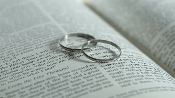 Thumbnail for Wedding Rings On Bible