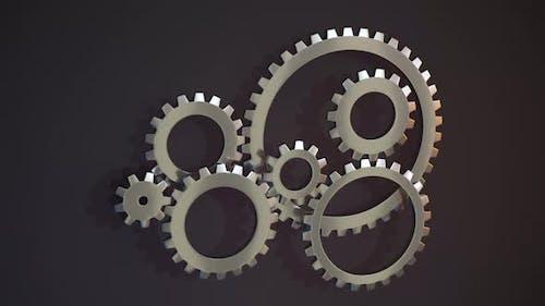 Rotation of mechanical gears, metallic parts.