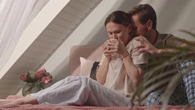 Loving Woman and Man in Bed