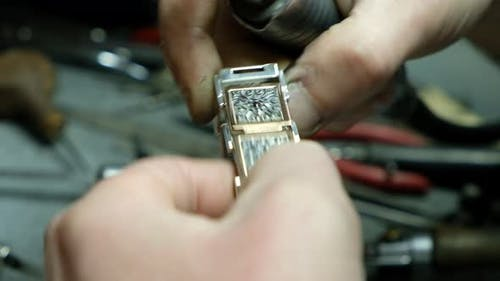 Hands of the Jeweler Polishes Ring on the Polishing Machine