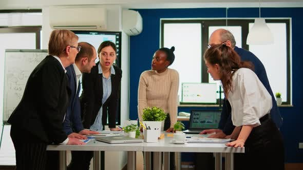 Diverse Businesspeople Brainstorming While Meeting at Company Office