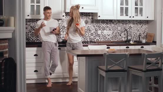 Thumbnail for Couple Using Smartphone During Breakfast