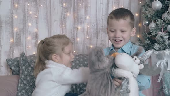 Fair Haired Brother and Sister Play Stuffed Animal Toys