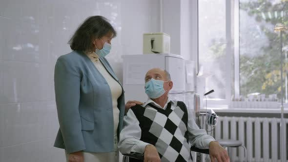 Thumbnail for Elder Woman and Ill Grey Haired Old Man in Protective Medical Masks Look at the Camera Male Patient