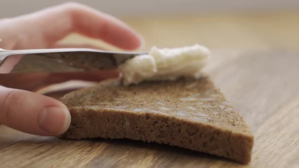 Man Cook Hands Making Toast with Hummus