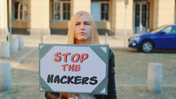 Concerned Woman with Protest Banner Calling to Stop Hackers