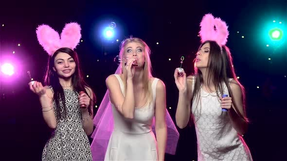 Cover Image for Girls at Bachelorette Party Blowing Soap Bubbles. Slow Motion