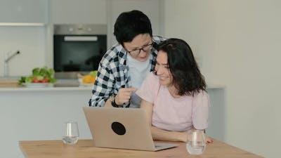 Woman Laughing at Funny Joke Meme Video on Internet While Browsing Internet Rbbro