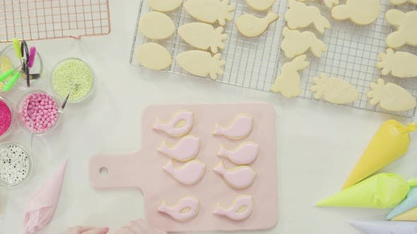 Time lapse. Step by step. Flat lay. Decorating Easter sugar cookies with royal icing