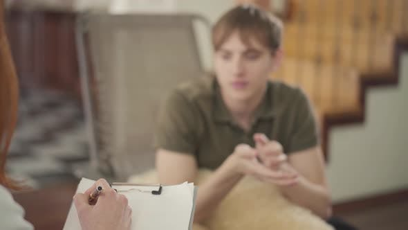 Thumbnail for Young Man Sitting in the Office of Psychologist, Telling Her About His Problems