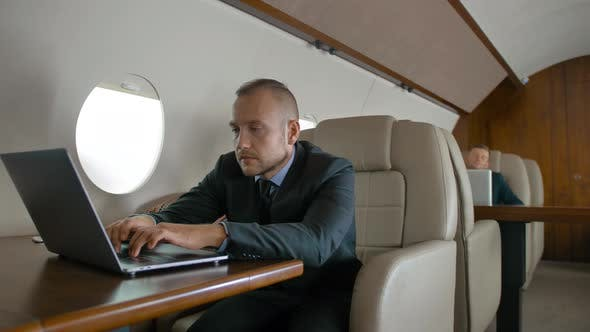 Thumbnail for Successful Businessman Traveling on His Private Jet