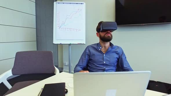 Cover Image for Businessman wearing virtual reality simulator