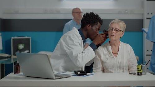 Healthcare Specialist Holding Professional Otoscope
