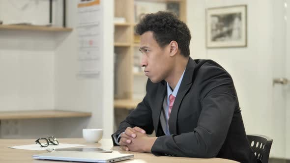 Thumbnail for Pensive African Businessman Thinking New Plan