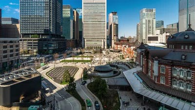 time lapse of Tokyo station, a railway station in the Marunouchi business district in Tokyo, Japan