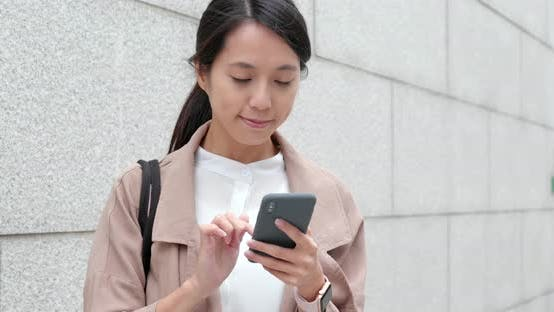 Thumbnail for Business woman use of mobile phone