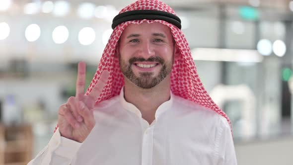 Thumbnail for Successful Arab Businessman Showing Victory Sign with Hand