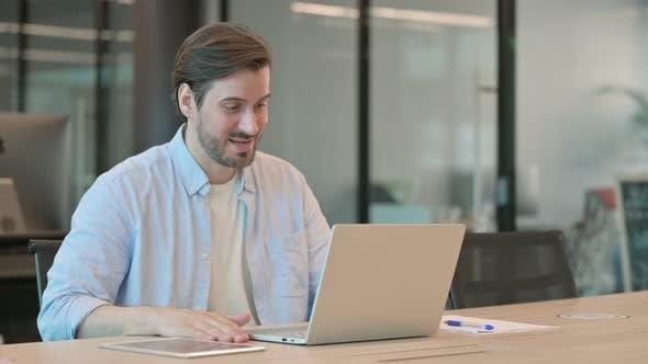 Man Talking on Video Chat on Laptop