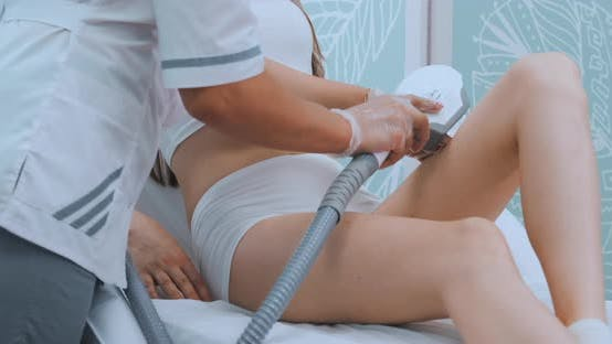 Thumbnail for Young Woman in White Bathrobe on Laser Hair Removal Procedure in Beautician Clinic, Slow Motion