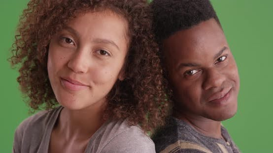 Thumbnail for Happy smiling African American man and woman lean on each other on green screen