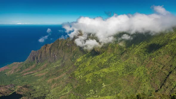 Cover Image for Time Lapse of the Clouds Swirling on Top of the Hawaii Island Tropical Mountains