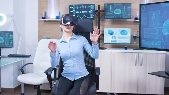 Young Female Using Virtual Reality Goggles in a Neurology Lab Science