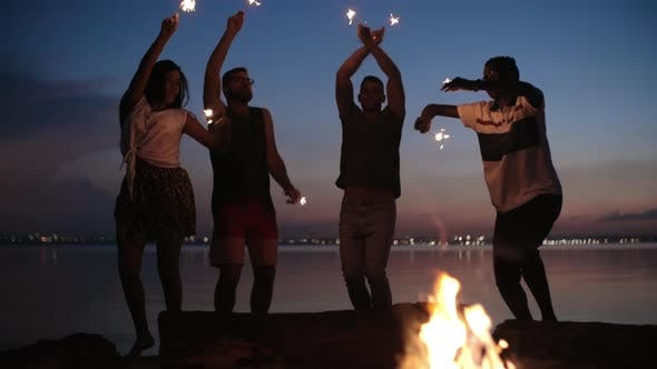 Thumbnail for Carefree Friends with Sparklers Dancing at Night