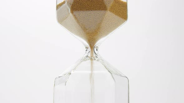 Closeup of a Sand Clock in the Middle of the Frame