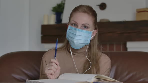 Thumbnail for Blond Woman in Face Mask Disagree with Someone in Video Chat