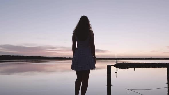 Depressed Woman Stepping Into Water To Commit Suicide