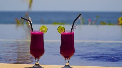 Glasses with a Cocktail Near the Pool