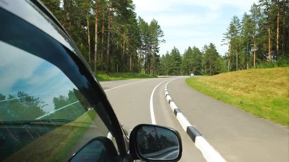 Car Moves On Curving Road