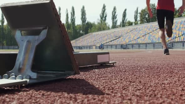 Thumbnail for Athlete Beginning to Run from Starting Blocks at Competition, Slow-Motion
