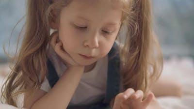 Closeup Child Plays on Smartphone