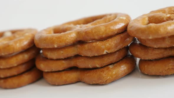 Close-up of popular snack food pretzel on white background  slow pan 4K 2160p 30fps UltraHD footage