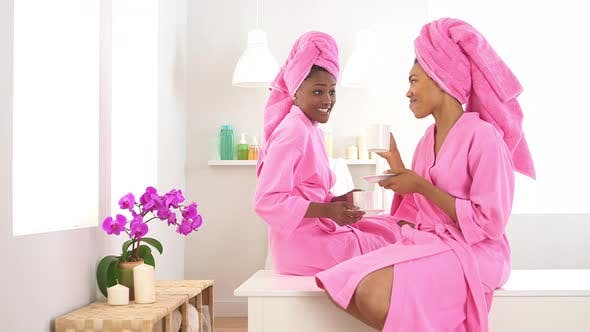 Thumbnail for Two African American friends drinking coffee in spa