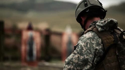 Soldier practices switching from rifle to pistol
