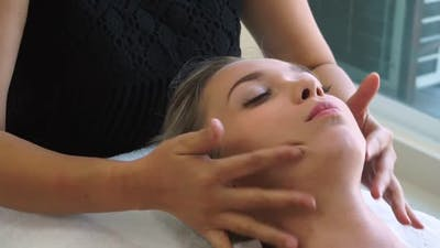 Woman Gets Facial and Head Massage in Luxury Spa