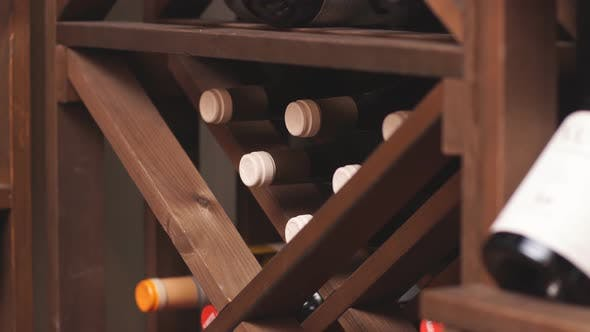 Bottles of Wine Are Stored on Shelves in Cellar of the Wine Shop