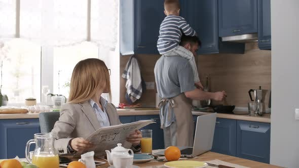 Thumbnail for Stay-At-Home Caucasian Husband and Son Cooking Breakfast for Busy Wife