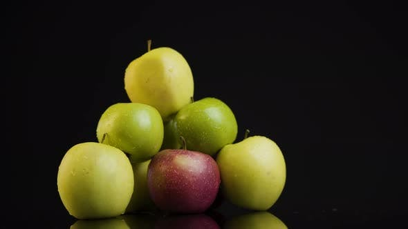 Thumbnail for A Pile of Green Apples on A Mirror Top on A Black Background. Surface Reflecting Pile of Apples