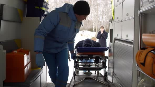 Thumbnail for EMTs Loading Man on Stretcher into Ambulance