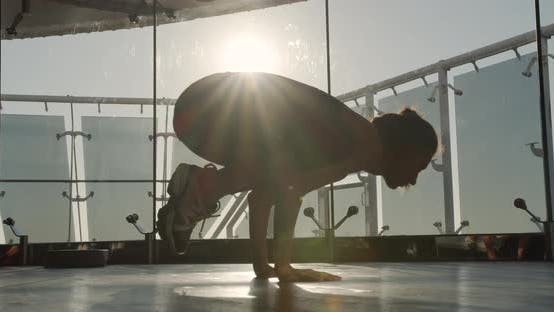 Girl at Dawn Performs Yoga Asana