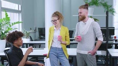 Startup Team Chatting During Coffee Break