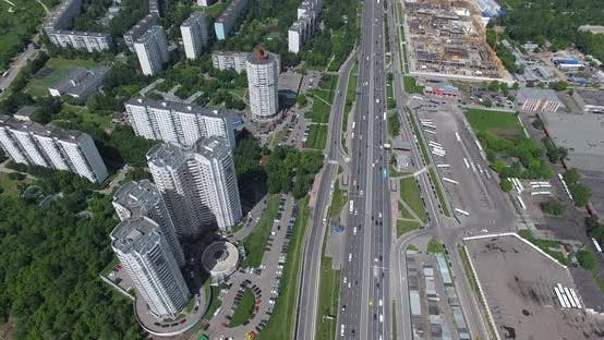 An Aerial View of a Busy Highway Next To the Multi Storey District