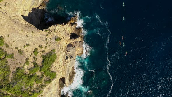 A Group of Athletes Swim in a Kayaks Around the Eastern Cape of the Island of Ibiza